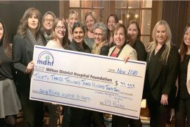 Featured image in which persons posing with check of a foundation